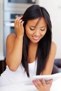 Young beautiful asian woman using her el