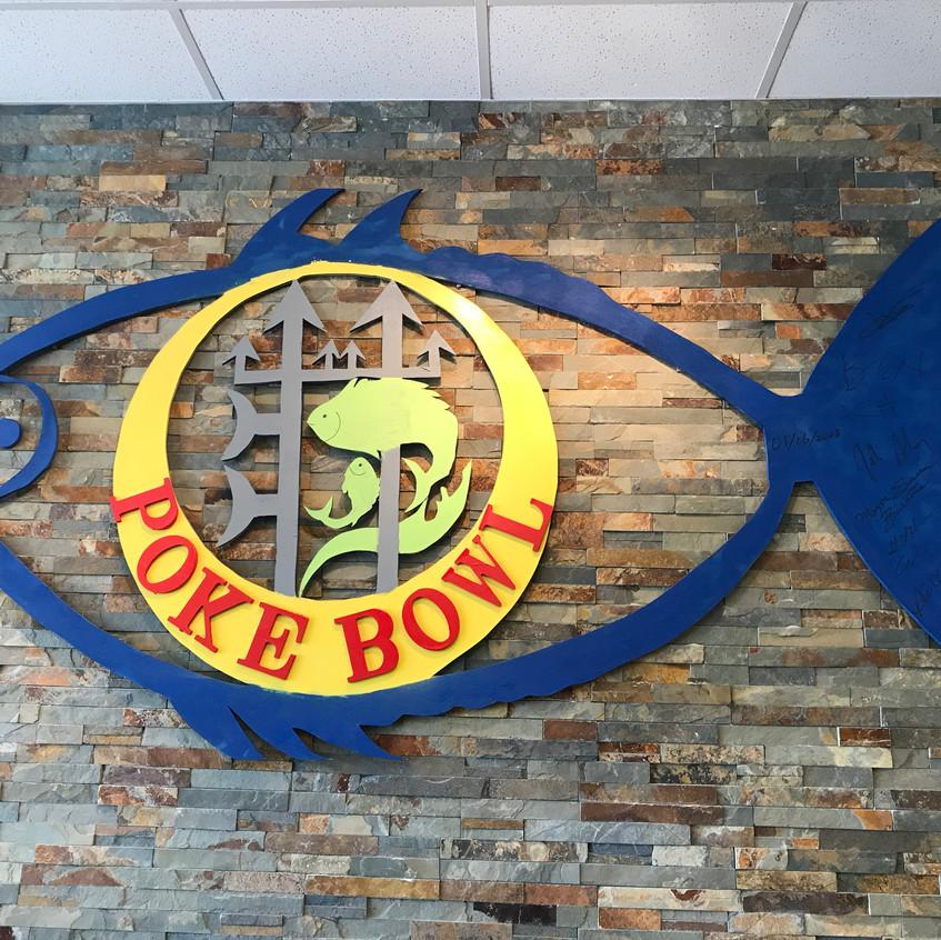 Bel Air Interior logo sign brick wall bc