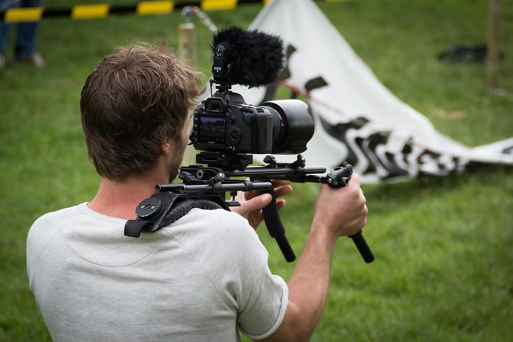 A camera operator capturing a fallen banner.