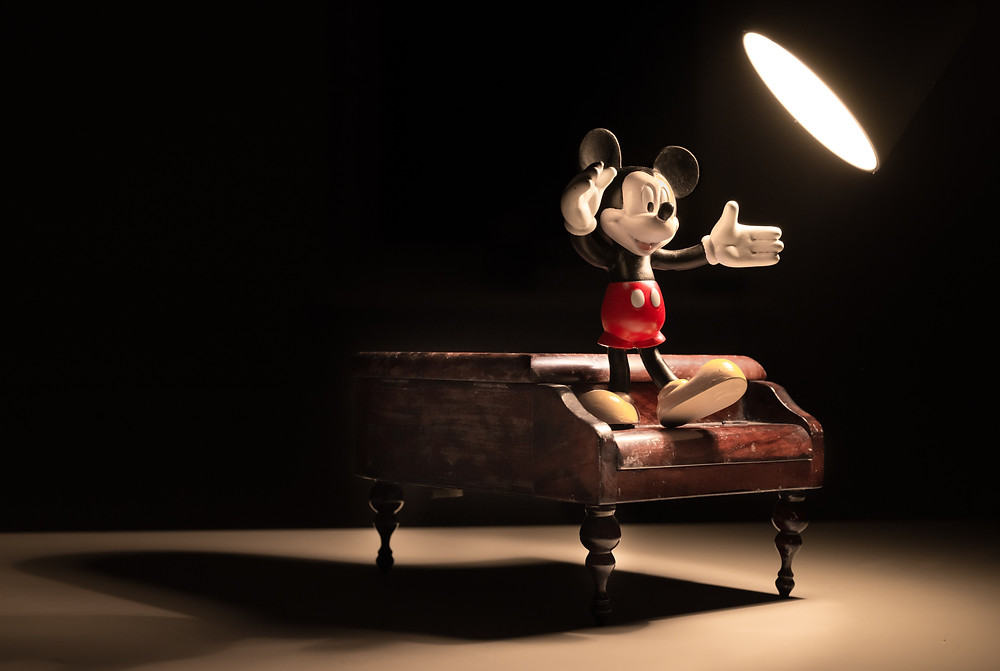 Mickey Mouse, famous Disney animated character, presenting himself to all of you reading