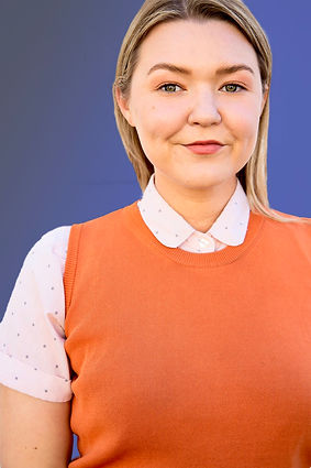 sweatervest smirk headshot.jpg