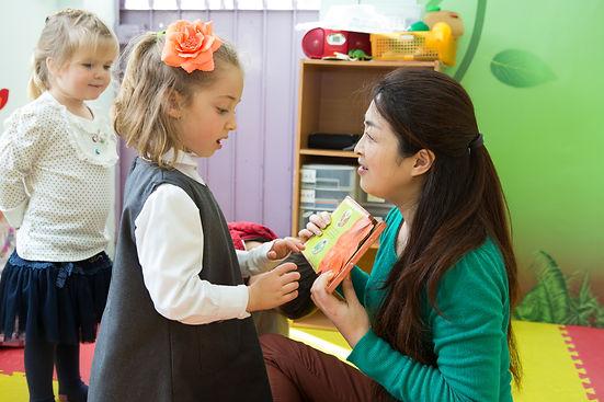 Mandarin teacher reads with a kid