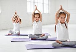 children girls doing yoga and gymnastics