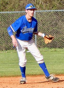 Matthew playing baseball