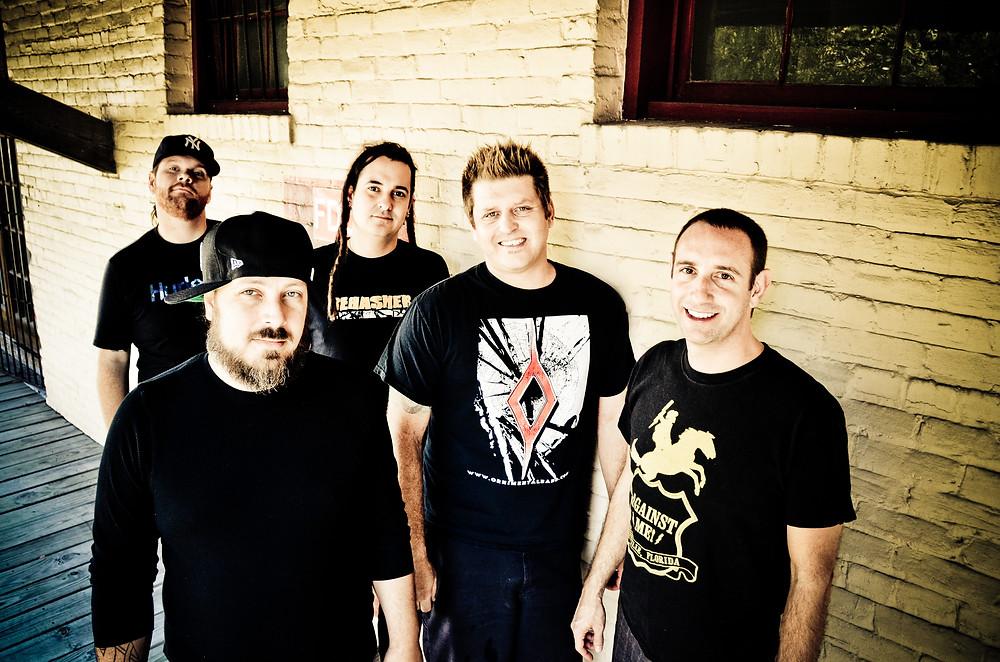 "less than jake Chris DeMakes (vocals, guitar), Roger Lima (vocals, bass), Vinnie Fiorello (drums, lyrics), Buddy Schaub (trombone) and Peter ""JR"" Wasilewski"
