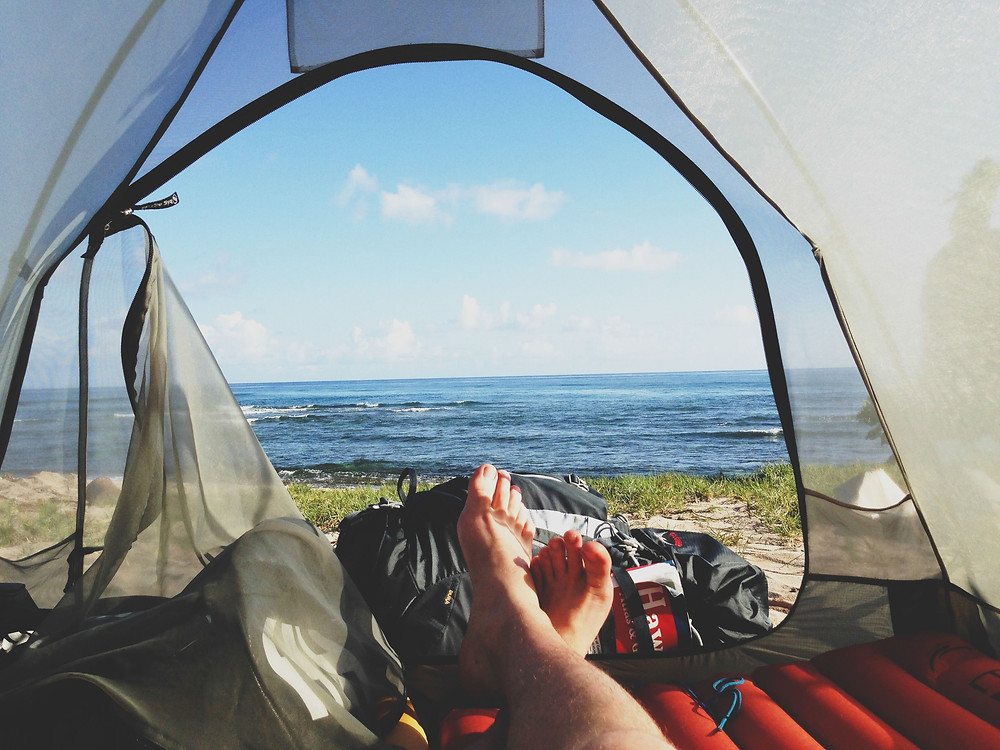 https://www.pexels.com/photo/adventure-camping-feet-morning-6757/