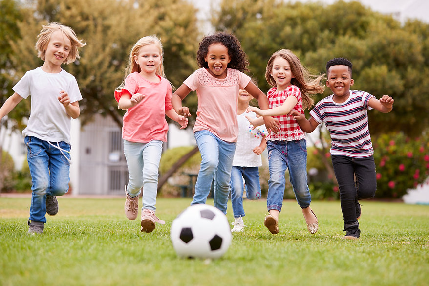 group-of-children-playing-football-with-