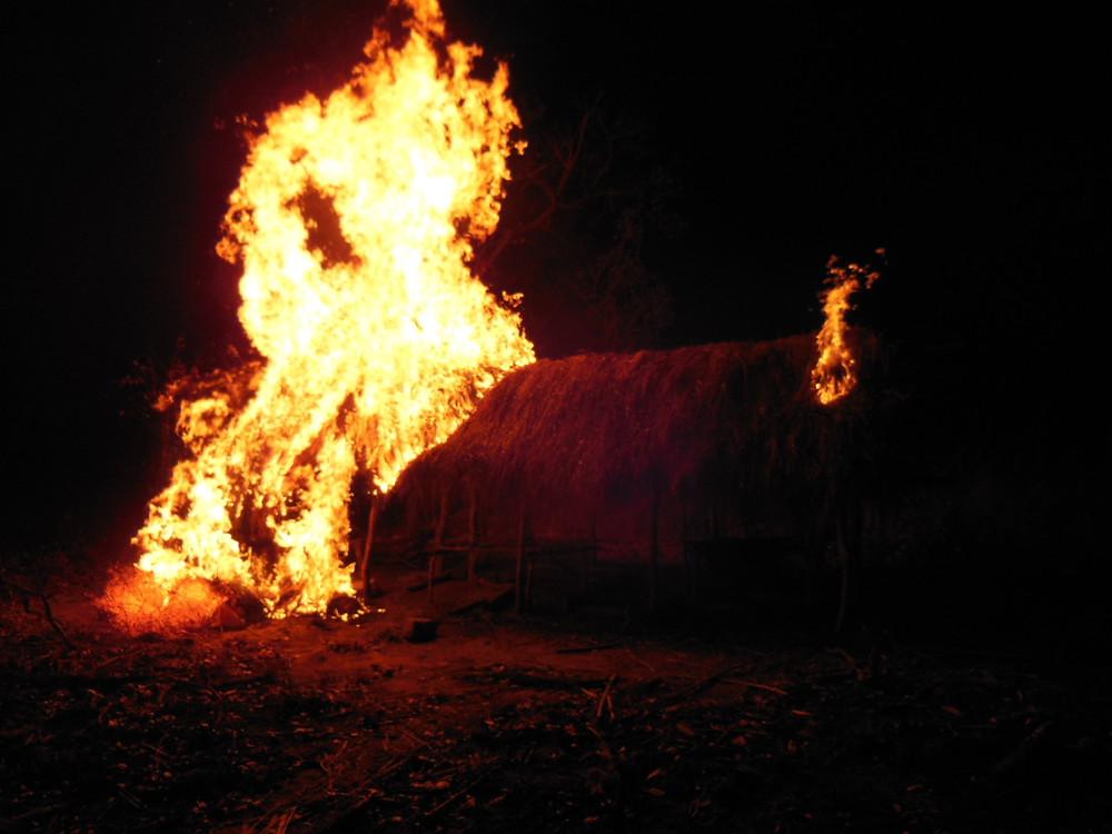 burning ivory poacher camp