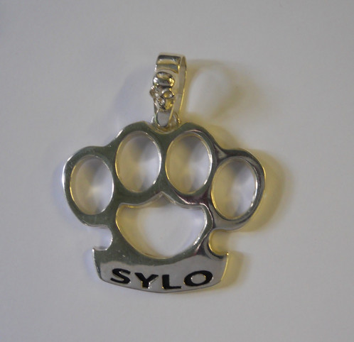 Sylo knuckle duster pendant motorcycle jewelry club jewelry sterling silver pendant made in the shape of brass knuckle duster with the sylo across the grip it measures 39mm wide and 37mm tall and weighs 1431 grams mozeypictures Choice Image