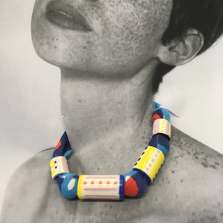 PROMOTIONAL IMAGE OF FABRIC AND CERAMIC NECKLACE