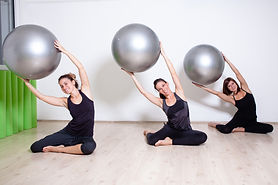 exercising with pilates balls.jpg