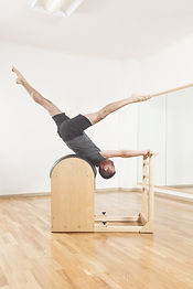 Pilates instructor performing fitness ex