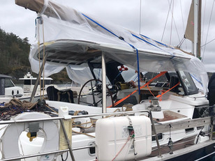 Gluing windows to our aluminium deckhouse on a Discovery 55 in the wind and the rain