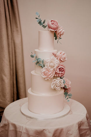 Wedding cake with white and pink sugar roses