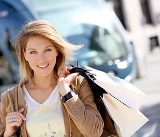 Cheerful%20woman%20with%20shopping%20bag