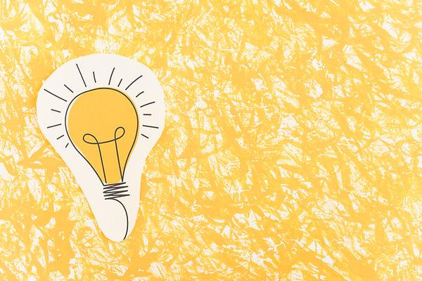 hand-drawn-light-bulb-cut-out-yellow-pattern-background.jpg