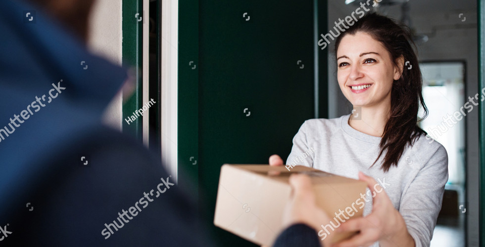 stock-photo-woman-receiving-parcel-from-