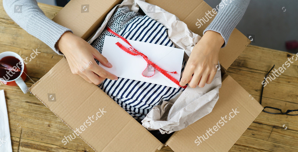 stock-photo-woman-packaging-a-christmas-