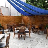 Yia Yia's Taverna Brooklyn backyard dining area.jpg