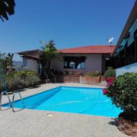 Pool view toward Casa Grande in blue sky