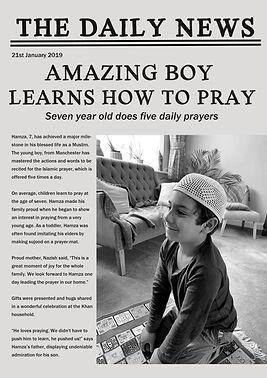 adam praying newspaper.jpg