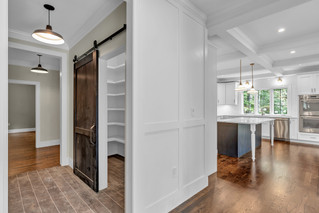 Built in millwork closet with barn-style sliding door