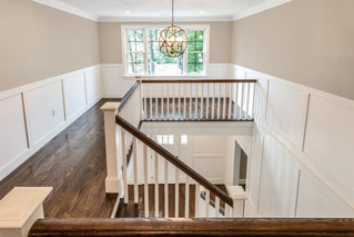 White and wood stair railing (2nd floor)