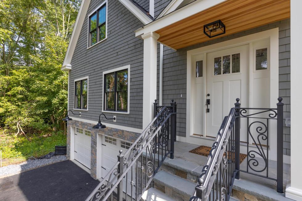 Custom home exteriors: siding, front porch and railing