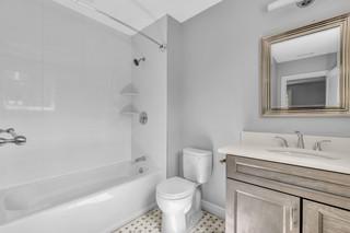 Small bathroom with bath tab