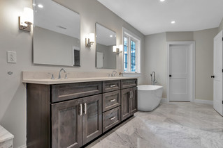 Double sink vanity and a white bath tub