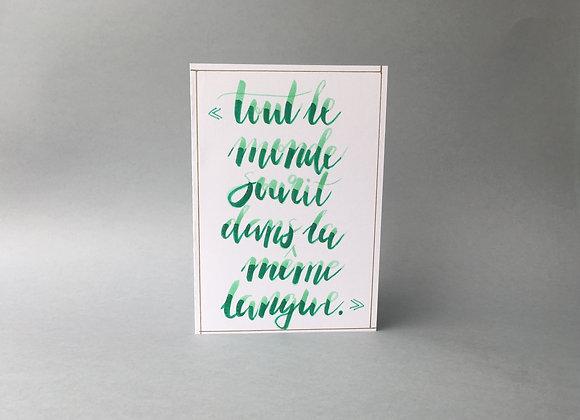 """Karte """"Tout le monde sourit dans la meme langue"""""""