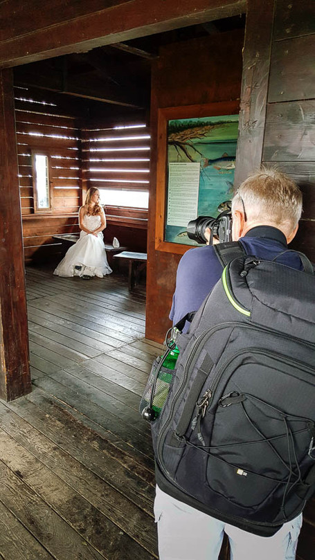 Wedding session - bride on location in Tuscany, with wedding  photographer at work