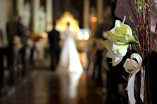 Flowers with a wedding ceremony in backg