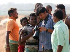 Ramnath with fishermen.jpg