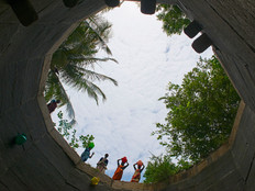 People taking water from well.jpg