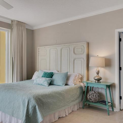 King bed with designed bed frame.