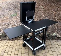 SingleRack with flip up lid storage, swing up mon mount, flip up side panels