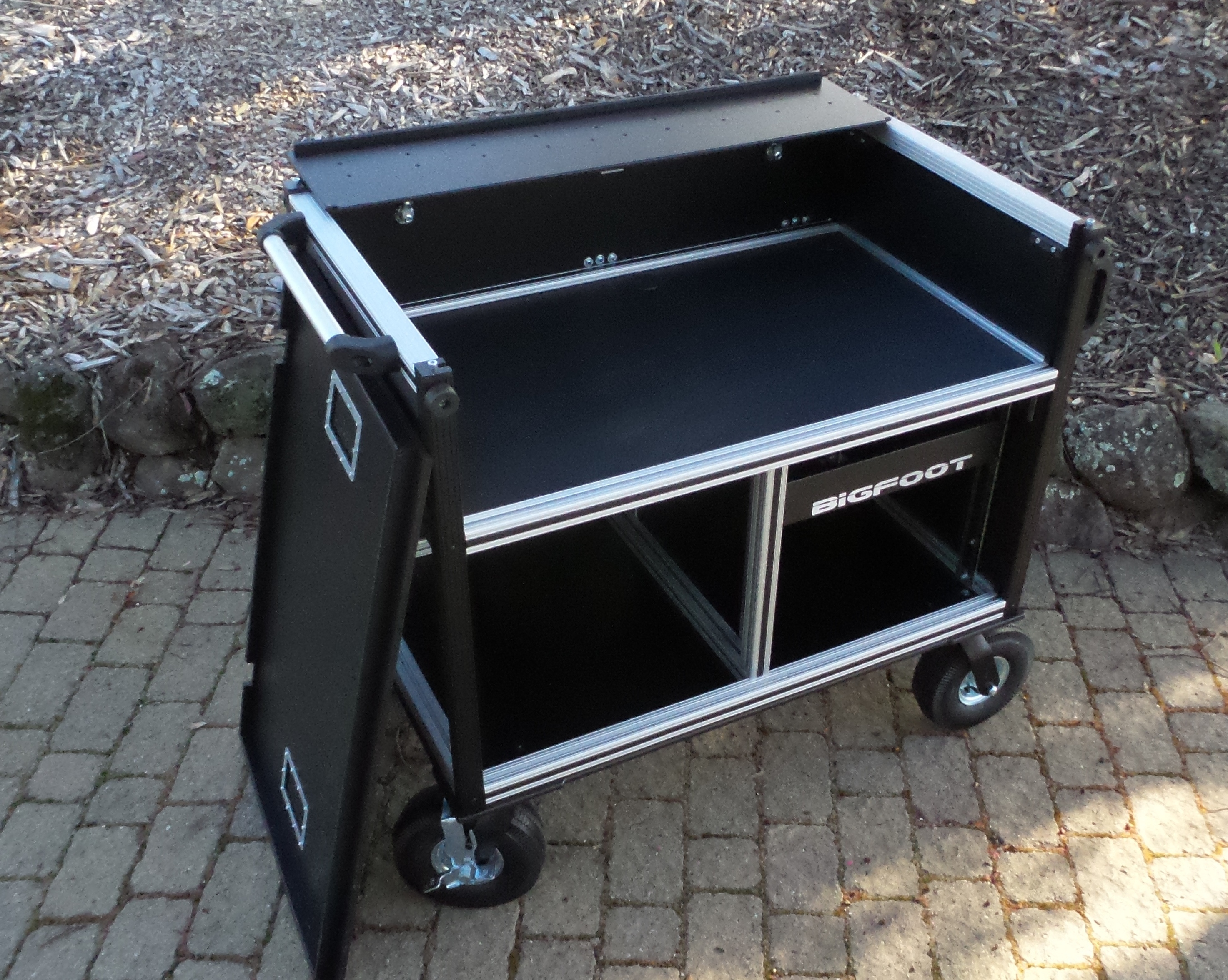Bigfoot Large Audio Console System with large turf wheels, lid off