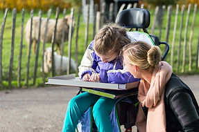 Disabled girl in a wheelchair relaxing o