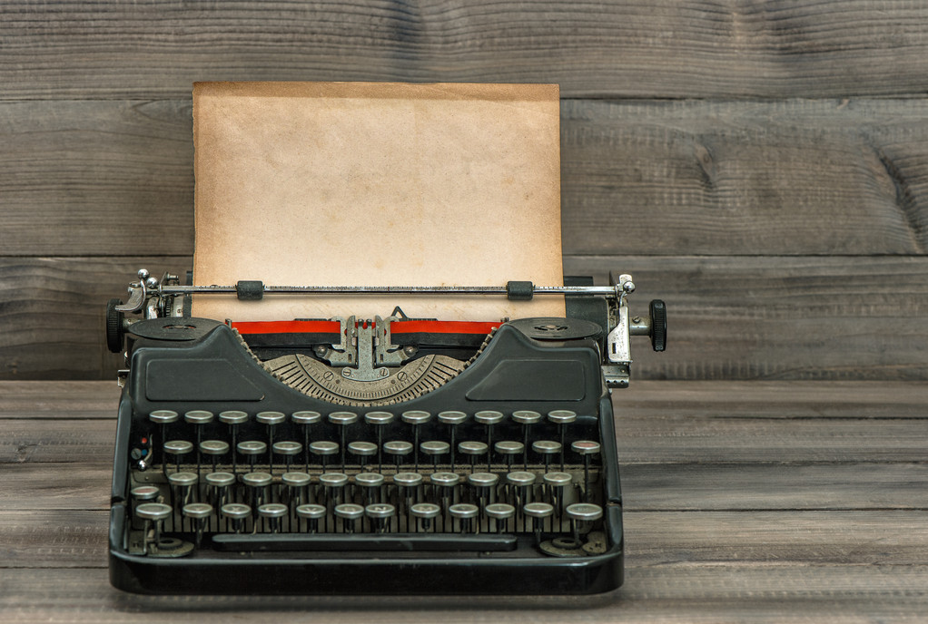 3340 antique typewriter with grungy textured paper page. vintage style still life.jpg