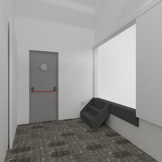 Pasillo a salida emergencia y puerta corredera y escaleras a lateral escenario.