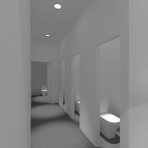 Entrada baños unisex, (3 baños más uno de minusválidos) desde pasillo lateral escenario.