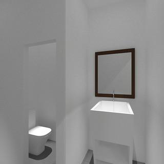 Vista general baños unisex con lavabo.