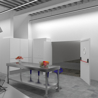 Vista cocina industrial con puerta de acceso a Sala Refectorio. Armarios, mesas de aluminio inoxidable.