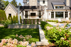 Back landscape with retaining wall and pergola Wheaton