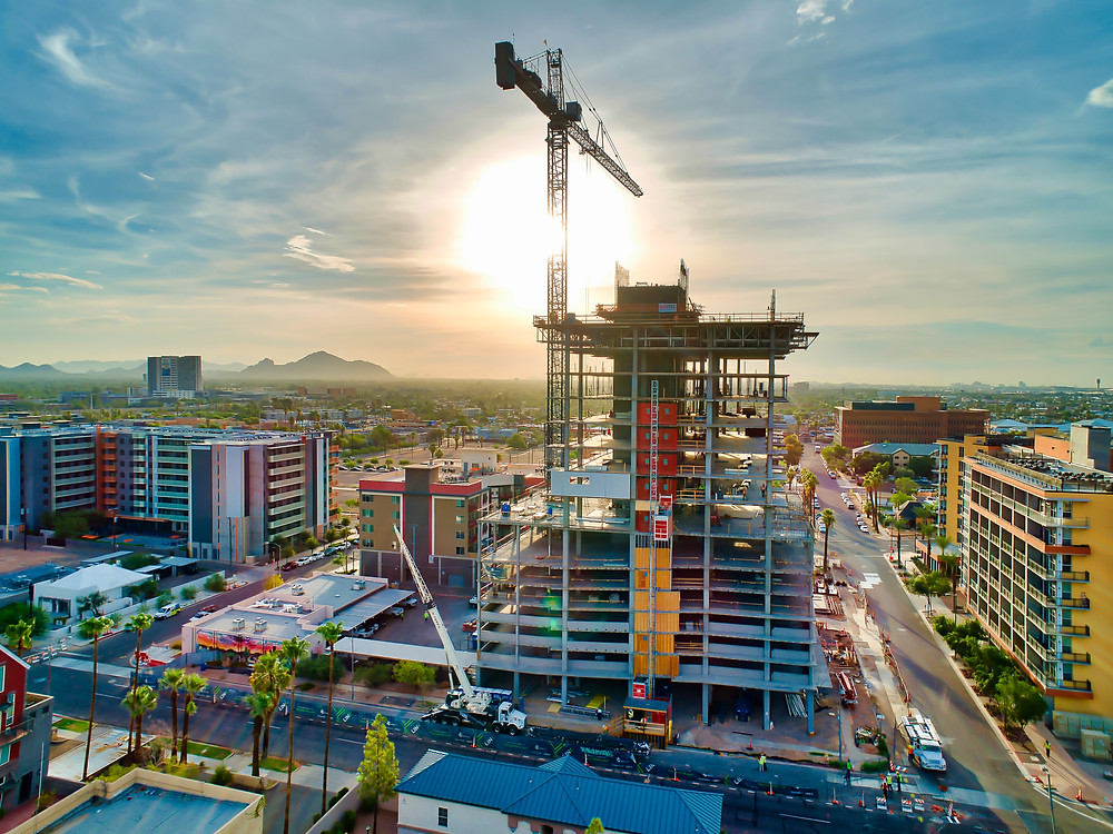 extreme aerial production drone image of building construction with crane