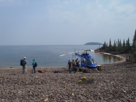 Field party disembarking from our transport, East Arm of Great Slave Lake