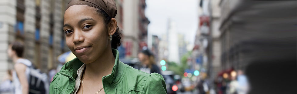 A foster care young woman smiles on the streets of NYC