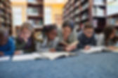 A group of NY children in foster care at the library