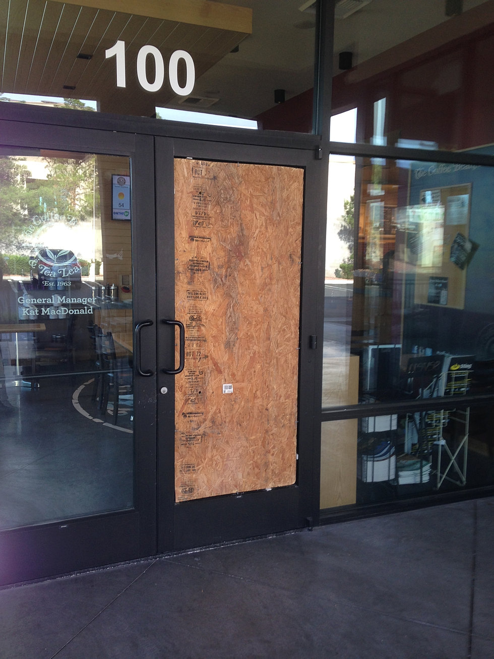 Frameless glass storefront door - Commercial Storefront Door Board Up